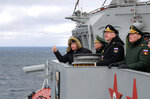 Russian President Vladimir Putin, left, Defense Minister Sergei Shoigu, second left, Commander-in-Chief of the Russian Navy Nikolai Yevmenov, second right, Commander of the Southern Military District troops Alexander Dvornikov, right, watch a navy exercise from the Marshal Ustinov missile cruiser in the Black Sea, Crimea, Thursday, Jan. 9, 2020. The drills involved warships and aircraft that launched missiles at practice targets. (Alexei Druzhinin, Sputnik, Kremlin Pool Photo via AP)