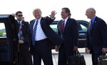 FILE - In this Sept. 6, 2018, file photo, President Donald Trump waves as he walks off of Air Force One at Billings Logan International Airport in Billings, Mont., with Sen. Steve Daines, R-Mont., second from right, and Rep Greg Gianforte, R-Mont. Since bonding on family camping trips more than two decades ago, Daines and Gianforte have worked in tandem, first to attain huge riches in the corporate world and more recently to leverage that success into a political juggernaut that's pushing Montana's Republican party further to the right. (AP Photo/Susan Walsh)