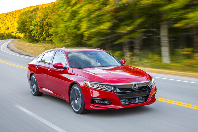This photo provided by Honda shows the 2018 Honda Accord, a midsize sedan that's available with a manual transmission. The Accord makes an excellent family car, and the manual transmission provides an added level of driver engagement. (Courtesy American Honda Motor Co. via AP)