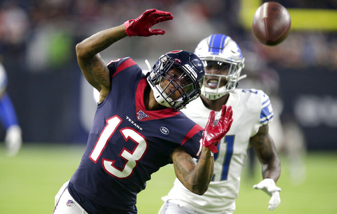 Houston Texans wide receiver Tyron Johnson (13) reaches for an incomplete pass as Detroit Lions cornerback Jamar Summers (21) defends during the second half of an NFL preseason football game Saturday, Aug. 17, 2019, in Houston. (AP Photo/Michael Wyke)