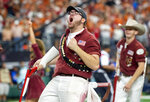 An Okahoma Rufnek celebrates a touchdown against Texas during the second half of the Big 12 Conference championship NCAA college football game on Saturday, Dec. 1, 2018, in Arlington, Texas. Oklahoma won 39-27. (AP Photo/Jeffrey McWhorter)