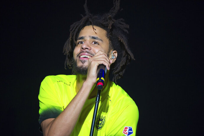 FILE, In this Oct. 1, 2016 photo, J. Cole performs at the 2016 The Meadows Music and Arts Festivals at Citi Field, in New York. J. Cole is set to perform at the BET Awards on Sunday, June 24, 2018. A person familiar with the awards show, who spoke on the condition of anonymity because the person was not allowed to discuss the plans publicly, tells The Associated Press on Friday, June 22, that the rapper will perform at the show. (Photo by Scott Roth/Invision/AP, File)