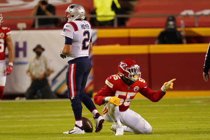 Kansas City Chiefs defensive end Frank Clark (55) celebrates after sacking New England Patriots quarterback Brian Hoyer (2) during the first half of an NFL football game, Monday, Oct. 5, 2020, in Kansas City. (AP Photo/Charlie Riedel)