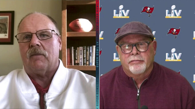 In this still image from video provided by the NFL, Kansas City Chiefs head coach Andy Reid, left, and Tampa Bay Buccaneers head coach Bruce Arians speak during Super Bowl 55 Opening Night, Monday, Feb. 1, 2021. (NFL via AP)