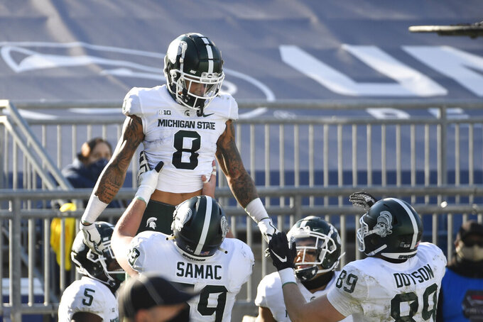Michigan State wide receiver Jalen Nailor (8) celebrates his touchdown reception with teammates during the second quarter of an NCAA college football game against Penn State in State College, Pa., on Saturday, Dec. 12, 2020. (AP Photo/Barry Reeger)