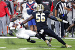 Tampa Bay Buccaneers quarterback Jameis Winston (3) slides on a carry as New Orleans Saints outside linebacker Demario Davis (56) closes in, in the first half of an NFL football game in New Orleans, Sunday, Oct. 6, 2019. (AP Photo/Bill Feig)