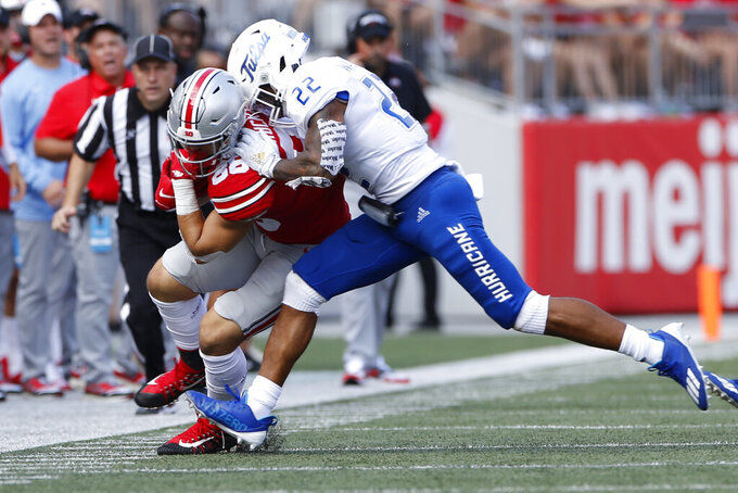 Tulsa defensive back LJ Wallace, right, forces Ohio State tight end Jeremy Ruckert out of bounds during the first half of an NCAA college football game Saturday, Sept. 18, 2021, in Columbus, Ohio. (AP Photo/Jay LaPrete)