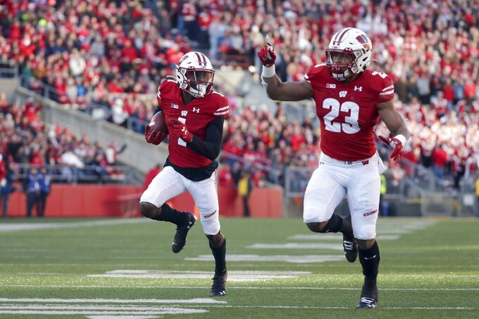 Wisconsin's Aron Cruickshank runs for a touchdown during the first half of an NCAA college football game against Purdue Saturday, Nov. 23, 2019, in Madison, Wis. (AP Photo/Morry Gash)