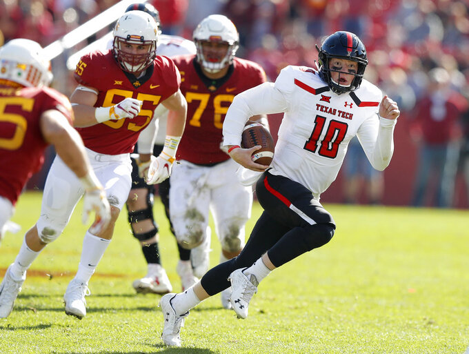 FILE - In this Oct. 27, 2018, file photo, Texas Tech quarterback Alan Bowman runs upfield during the second half of an NCAA college football game against Iowa State in Ames, Iowa. Bowman is the Big 12's leading passer. (AP Photo/Charlie Neibergall, File)