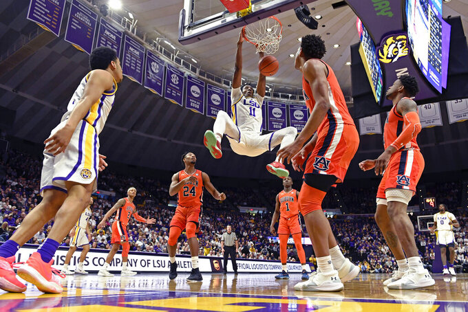 LSU forward Kavell Bigby-Williams (11) dunks the ball against Auburn in the first half of an NCAA college basketball game, Saturday, Feb. 9, 2019, in Baton Rouge, La. (AP Photo/Bill Feig)