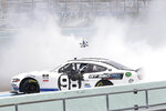 Chase Briscoe does a burnout after winning a NASCAR Xfinity Series auto race Sunday, June 14, 2020, in Homestead, Fla. (AP Photo/Wilfredo Lee)
