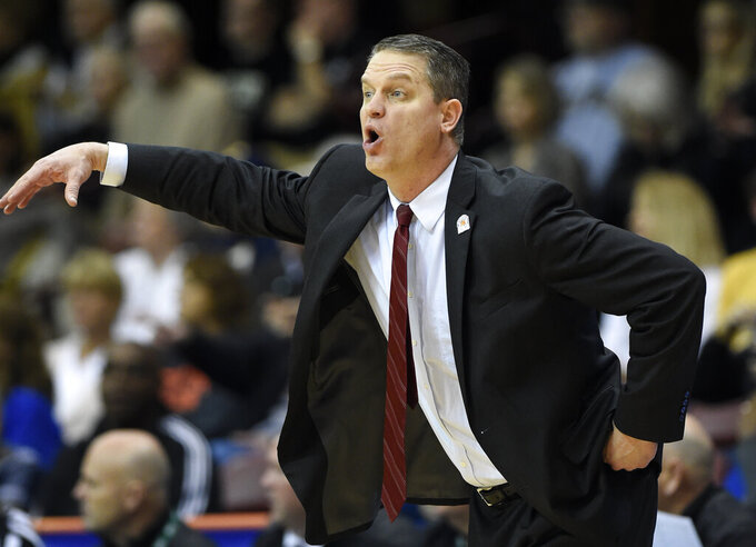 VMI head coach Dan Earl directs his team in the first half of an NCAA college basketball game against Wofford in the Southern Conference tournament championship, Saturday, March 9, 2018, in Asheville, N.C. Wofford won 97-72. (AP Photo/Kathy Kmonicek)