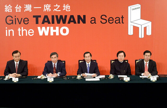 FILE - In this May 11, 2007, file photo, then Taiwan's President Chen Shui-bian, center, answers questions from Geneva-based journalists during a video conference where he protested the World Health Organization's rejection of the island's latest bid for membership, at the Presidential Palace in Taipei, Taiwan. Taiwan has called repeatedly for it to be allowed to participate in WHO, from which it has been barred by China. So strong is China's diplomatic pressure that Taiwan can no longer take part in the organization's annual World Health Assembly, even as an observer. (AP Photo, File)