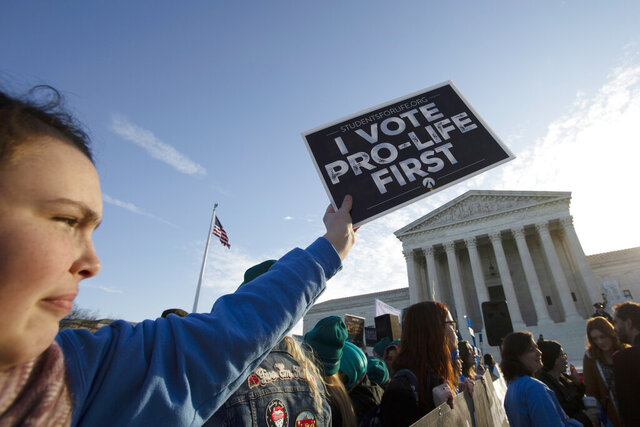 Anti-abortion demonstrators rally outside of the U.S. Supreme Court in Washington, Wednesday, March 4, 2020. The Supreme Court is taking up the first major abortion case of the Trump era Wednesday, an election-year look at a Louisiana dispute that could reveal how willing the more conservative court is to roll back abortion rights. (AP Photo/Jose Luis Magana)