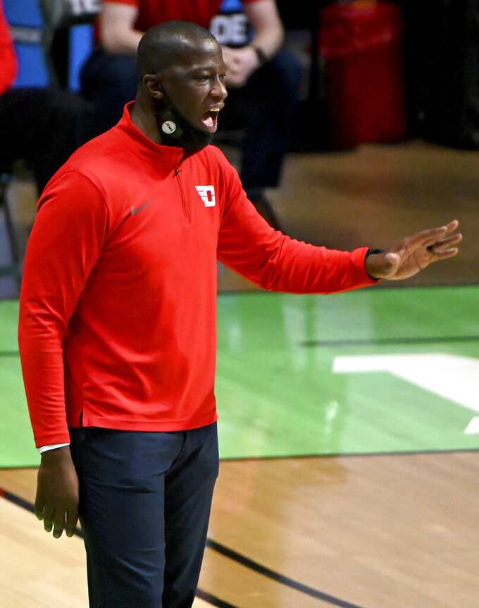Dayton head coach Anthony Grant calls a play in the first half of an NCAA college basketball game against Memphis in the first round of the NIT Tournament, Saturday, March 20, 2021, in Denton, Texas. (AP Photo/Matt Strasen)