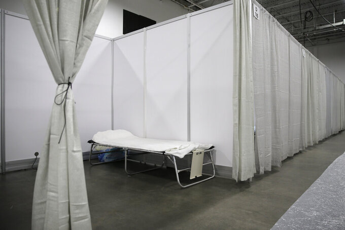 A sparse room is seen at the field medical station set up at the Meadowlands Exposition Center in Secaucus, N.J., Thursday, April 2, 2020. New Jersey Gov. Phil Murphy toured the medical station that is expected to open early next week. It is slated to field non-coronavirus cases. It's one of four such facilities that are supposed to open in New Jersey. (AP Photo/Seth Wenig)