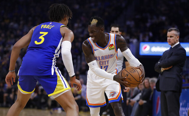 Oklahoma City Thunder guard Dennis Schroder, right, drives the ball against Golden State Warriors' Jordan Poole (3) during the first half of an NBA basketball game Monday, Nov. 25, 2019, in San Francisco. (AP Photo/Ben Margot)