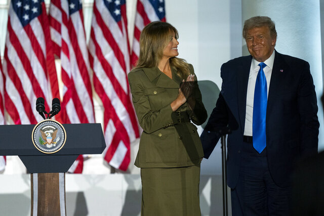 President Donald Trump joins first lady Melania Trump on stage after her speech to the 2020 Republican National Convention from the Rose Garden of the White House, Tuesday, Aug. 25, 2020, in Washington. (AP Photo/Evan Vucci)