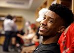 FILE - In this March 23, 2019, file photo, Texas Tech guard Jarrett Culver talks to reporters in the locker room after practice for their second round men's college basketball game in the NCAA Tournament, in Tulsa, Okla. Texas Tech has gotten to its first Final Four with contrasting guards Jarrett Culver and Matt Mooney. Culver is the sophomore standout who stayed home to play after Chris Beard became coach of the Red Raiders. (AP Photo/Charlie Riedel, File)