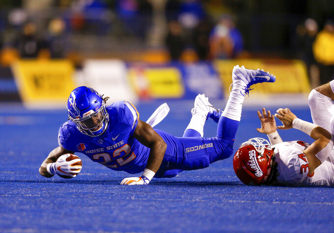 Boise State running back Alexander Mattison (22) dives for a few extra yards on a carry against Fresno State during the first half of an NCAA college football game Friday, Nov. 9, 2018, in Boise, Idaho. (AP Photo/Steve Conner)