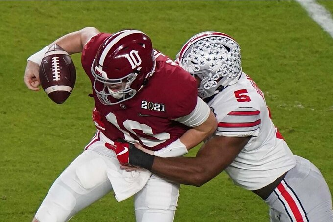 Ohio State linebacker Baron Browning forces a fumble by Alabama quarterback Mac Jones during the first half of an NCAA College Football Playoff national championship game, Monday, Jan. 11, 2021, in Miami Gardens, Fla. (AP Photo/Wilfredo Lee)