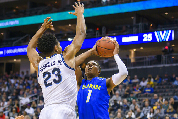 Villanova forward Jermaine Samuels (23) defends as Delaware guard Kevin Anderson (1) shoots during the first half of the Never Forget Tribute Classic NCAA college basketball game, Saturday, Dec. 14, 2019, in Newark, N.J. (AP Photo/Corey Sipkin)