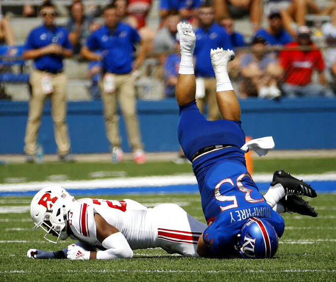 Kansas fullback Caperton Humphrey (35) is upended by Rutgers defensive back Kiy Hester (23) during the first half of an NCAA college football game Saturday, Sept. 15, 2018, in Lawrence. (AP Photo/Charlie Riedel)
