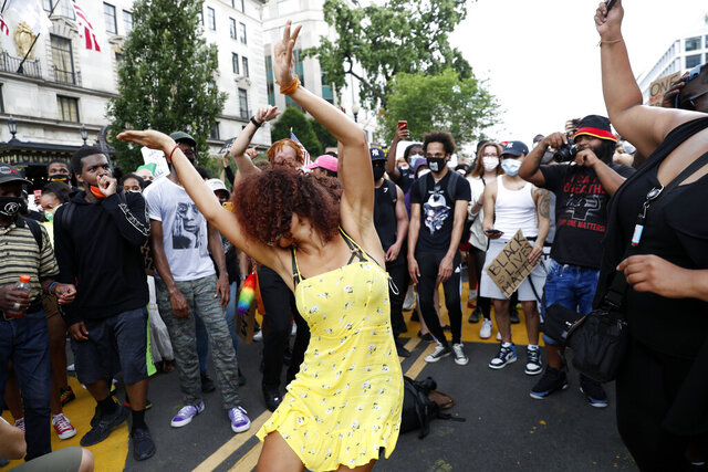 Demonstrator dance as they protest Saturday, June 6, 2020, near the White House in Washington, over the death of George Floyd, a black man who was in police custody in Minneapolis. Floyd died after being restrained by Minneapolis police officers. (AP Photo/Jacquelyn Martin)