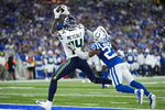 Seattle Seahawks wide receiver DK Metcalf (14) makes a catch in front of Indianapolis Colts cornerback Kenny Moore II (23) for a touchdown during the second half of an NFL football game in Indianapolis, Sunday, Sept. 12, 2021. (AP Photo/AJ Mast)