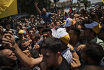 FILE - In this Sunday, Aug. 25, 2019, photo, mourners chant angry slogans as others carry the body of Palestinian activist Tamer Sultan, 38, during his funeral in the town of Beit Lahiya, northern Gaza Strip. The death abroad of a Palestinian who fled the Gaza Strip seeking a better life in Europe has highlighted the exodus of thousands of middle-class residents in recent years. Tamer al-Sultan's friends and family say he fled the oppressive rule of Hamas. Others are leaving because of the dire conditions in the territory, which has been under an Israeli and Egyptian blockade since the Islamic militant group seized power 12 years ago. (AP Photo/Khalil Hamra)