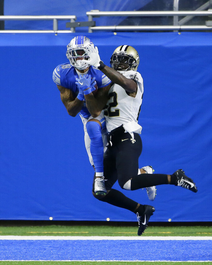 Detroit Lions wide receiver Kenny Golladay, defended by New Orleans Saints safety Chauncey Gardner-Johnson (22) catches a 15-yard pass in the end zone for a touchdown during the first half of an NFL football game, Sunday, Oct. 4, 2020, in Detroit. (AP Photo/Duane Burleson)