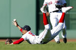 Boston Red Sox's Mookie Betts dives for an RBI single by Tampa Bay Rays' Kevin Kiermaier during the ninth inning of the first game of a baseball doubleheader in Boston, Saturday, June 8, 2019. (AP Photo/Michael Dwyer)