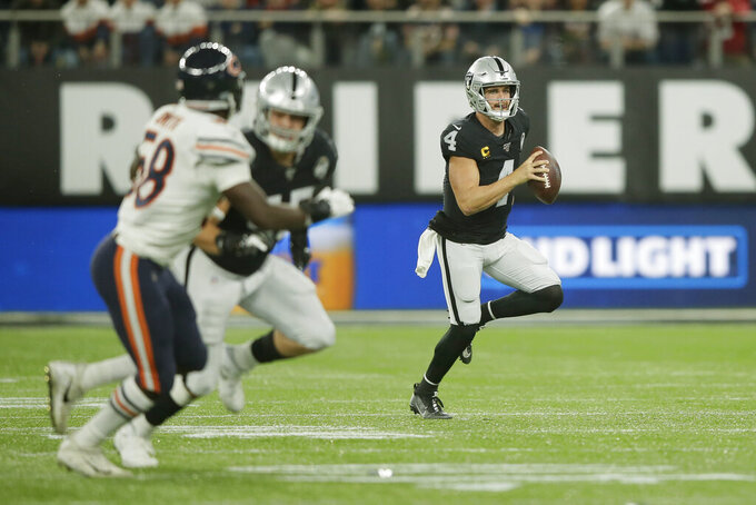 Oakland Raiders quarterback Derek Carr (4) runs during the first half of an NFL football game against the Chicago Bears at Tottenham Hotspur Stadium, Sunday, Oct. 6, 2019, in London. (AP Photo/Tim Ireland)