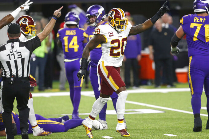 Washington Redskins strong safety Landon Collins (20) celebrates after his team recovered a fumble by Minnesota Vikings wide receiver Stefon Diggs during the first half of an NFL football game, Thursday, Oct. 24, 2019, in Minneapolis. (AP Photo/Jim Mone)