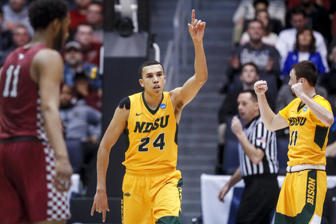 North Dakota State's Tyson Ward reacts after the team's win over North Carolina Central in a First Four game of the NCAA men's college basketball tournament Wednesday, March 20, 2019, in Dayton, Ohio. (AP Photo/John Minchillo)