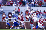 Oklahoma quarterback Spencer Rattler (7) spins over Kansas safety Ricky Thomas (3) while scoring a touchdown during an NCAA college football game in Norman, Okla., Saturday, Nov. 7, 2020. (Ian Maule/Tulsa World via AP)