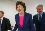 FILE - In this June 18, 2019, file photo, Sen. Susan Collins, R-Maine, arrives at the Capitol in Washington to extend her perfect Senate voting record to 7,000. Democratic House Speaker Sara Gideon is driving home her attack on Collins for accepting corporate donations. (AP Photo/J. Scott Applewhite, File)