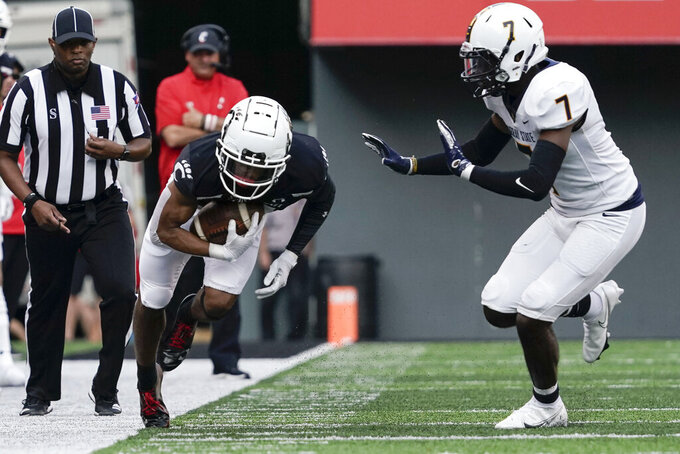 Cincinnati wide receiver Tyler Scott, front left, runs out of bounds after making a catch during the second half of an NCAA college football game against Murray State, Saturday, Sept. 11, 2021, in Cincinnati. (AP Photo/Jeff Dean)