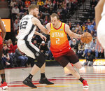 Utah Jazz forward Joe Ingles (2) dribbles past San Antonio Spurs forward Davis Bertans (42) during the first quarter of an NBA basketball game, Saturday, Feb. 9, 2019, in Salt Lake City. (AP Photo/Chris Nicoll)