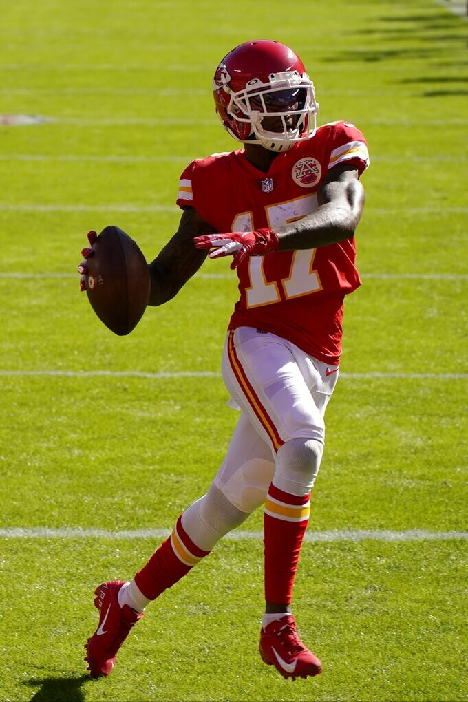 Kansas City Chiefs wide receiver Mecole Hardman (17) celebrates after catching a pass for a touchdown in the first half of an NFL football game against the New York Jets on Sunday, Nov. 1, 2020, in Kansas City, Mo. (AP Photo/Charlie Riedel)