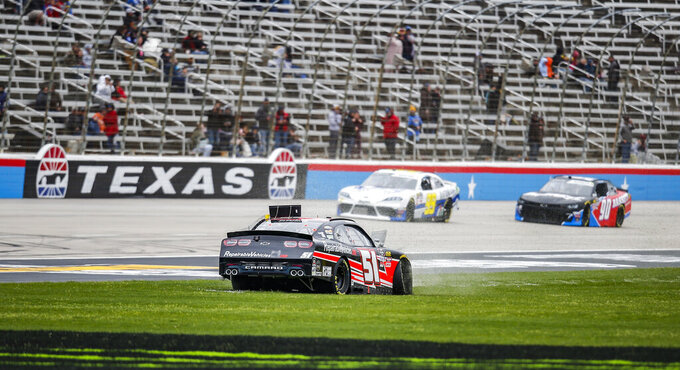 Jeremy Clements spins out into the grass on the front stretch during a NASCAR auto race at Texas Motor Speedway, Saturday, March 30, 2019, in Fort Worth, Texas. (AP Photo/Brandon Wade)
