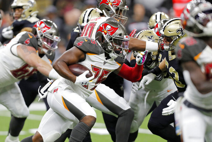 Tampa Bay Buccaneers running back Peyton Barber carries in the first half of an NFL football game against the New Orleans Saints in New Orleans, Sunday, Oct. 6, 2019. (AP Photo/Gerald Herbert)