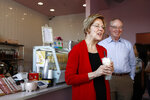 Democratic presidential candidate Sen. Elizabeth Warren, D-Mass., and her husband Bruce Mann visit with customers at a shopping center in the Chinatown neighborhood of Las Vegas, Saturday, Feb. 15, 2020. (AP Photo/Patrick Semansky)