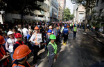 People gather in the street after evacuating their office buildings during an earthquake drill, commemorating the 34th anniversary of the 1985 earthquake, in Mexico City, Thursday, Sept. 19, 2019. The 8.1-magnitude earthquake killed as many as 10,000 and left thousands homeless. The date also commemorates the 2017 earthquake that rattled the city killing hundreds. (AP Photo/Eduardo Verdugo)