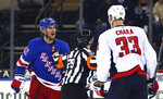 New York Rangers' Brendan Smith (42) has words for Washington Capitals' Zdeno Chara (33) during the second period of an NHL hockey game Wednesday, May 5, 2021, in New York. (Bruce Bennett/Pool Photo via AP)