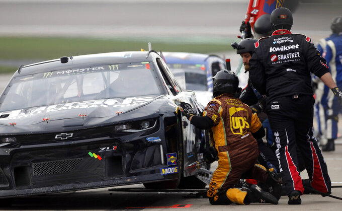 Casey Mears makes a pit stop during the NASCAR Cup Series auto race at Kansas Speedway in Kansas City, Kan., Saturday, May 11, 2019. (AP Photo/Colin E. Braley)
