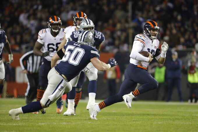 Chicago Bears quarterback Mitchell Trubisky (10) is chased by Dallas Cowboys' Sean Lee (50) during the first half of an NFL football game, Thursday, Dec. 5, 2019, in Chicago. (AP Photo/Morry Gash)