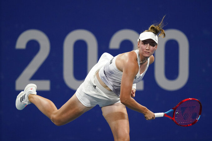 Elena Rybakina, of Kazakhstan, serves to Donna Vekic, of Croatia, during the third round of the women's tennis competition at the 2020 Summer Olympics, Tuesday, July 27, 2021, in Tokyo, Japan. (AP Photo/Patrick Semansky)