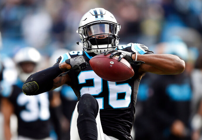 FILE - This Dec. 17, 2017 file photo shows Carolina Panthers' Daryl Worley (26) celebrating his interception against the Green Bay Packers during the first half of an NFL football game in Charlotte, N.C. The Philadelphia Eagles have released Worley hours after he was arrested. NFL Network reported that Worley was arrested Sunday, April 15, 2018 near the team's practice facility and that police used a Taser on him after he became combative. The Eagles traded wide receiver Torrey Smith to the Carolina Panthers for Worley in March. (AP Photo/Mike McCarn)