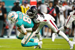 Atlanta Falcons safety Dwayne Johnson Jr. (37) tackles Miami Dolphins tight end Mike Gesicki (88) during the first half of a NFL preseason football game, Saturday, Aug. 21, 2021, in Miami Gardens. (AP Photo/Wilfredo Lee)